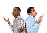 Closeup portrait of two men back to back putting hands in air looking up in frustration — Stock Photo