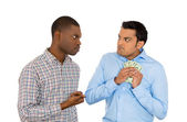 Closeup portrait of two men, one trying to steal money from the other, who is tightly holding cash and not willing to give it up — Stock Photo