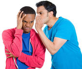 Closeup portrait of guy whispering into man's ear telling him something secret and disturbing. Shocked surprised disgusted wide open mouth response. — Stock Photo