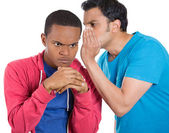 Closeup portrait of guy whispering into man's ear telling him something secret and disturbing. Shocked surprised disgusted wide open mouth response — Stock Photo