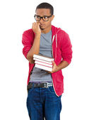 Closeup of a young handsome man, wearing big glasses, holding books, anxious in anticipation of finals, exam test — Zdjęcie stockowe