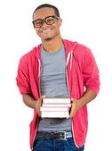 Closeup of a happy excited young handsome man holding books, ready to receive knowledge after enrollment in college — Stock Photo