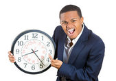 A closeup portrait of a business man, executive, leader holding a clock, very determined, pressured by lack of time, running out of time, late for the meeting — Stock Photo