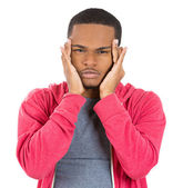 Young man having really bad headache pain placing both hands on temples — Stock Photo