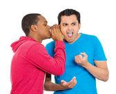 Guy whispering into man's ear — Stock Photo