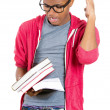 Young handsome man, wearing big glasses, holding books — Stock Photo #37980701