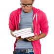 Young handsome man, wearing big glasses, holding books — Stock Photo #37981081