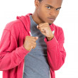 Angry, mad young man in red hoodie ready to box with fists in air — Stock Photo #37983161