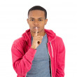 Young serious mplacing finger on lips as if to say — Stock Photo #37988173