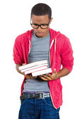 Young handsome man, wearing big glasses, holding books — Stock Photo