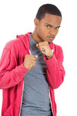Angry, mad young man in red hoodie ready to box with fists in air — Stock Photo