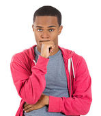 Young man thinking daydreaming deeply about something chin on hand looking upwards — Stock Photo