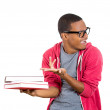Young handsome man, wearing big glasses, holding books — Stock Photo #38171011