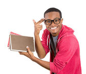 Young handsome man, wearing big glasses, holding books — Foto Stock