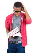 Young handsome man, wearing big glasses, holding books — Stok fotoğraf