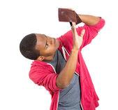 Man looking into empty wallet — Stock Photo