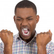 Screaming man squeezing his fists — Stock Photo
