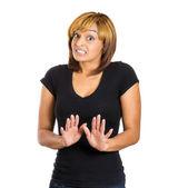 Shocked woman raising hands up — Стоковое фото