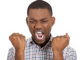 Screaming man squeezing his fists — Stockfoto
