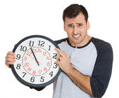Leader holding a clock — Foto de Stock
