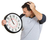 Leader holding a clock — Stockfoto