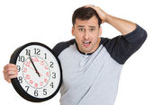 Leader holding a clock — Stock Photo