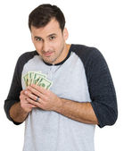 Man holding dollar banknotes — Stock Photo