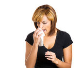 Sick woman blowing her nose — Stock Photo