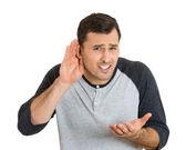 Man placing hand on ear — Zdjęcie stockowe