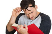 Man trying to read book — Stock Photo