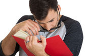 Guy trying to read book — Stock Photo