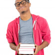 Man, wearing big glasses, holding books — Stock Photo #38581985