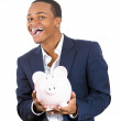 Stock Photo: Happy mwith piggy bank