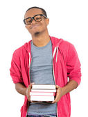 Man, wearing big glasses, holding books — Стоковое фото