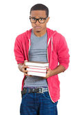 Man, wearing big glasses, holding books — Stockfoto