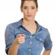 Woman pointing at someone — Stock Photo