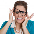 Woman with hands raised, glasses messed up on face — Stock Photo