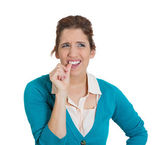 Woman with finger in mouth — Stock Photo