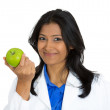 Female doctor holding an apple — Stock Photo