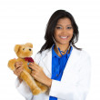 Female doctor holding teddy bear — Stock Photo