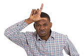 Man displaying loser sign — Stock Photo