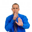 Man placing finger on lips — Stock Photo