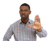 Angry young man placing flat hand — Stock Photo