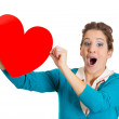 Woman holding red heart — Stock Photo #38936975