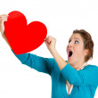 Woman holding red heart — Stock Photo