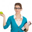 Woman holding books and apple — Stock Photo #38937301