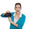 Stock Photo: Shocked girl holding empty wallet