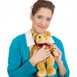Woman holding teddy bear — ストック写真