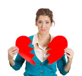 Woman holding broken heart — Stock Photo