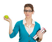 Woman holding books and apple — Stock Photo